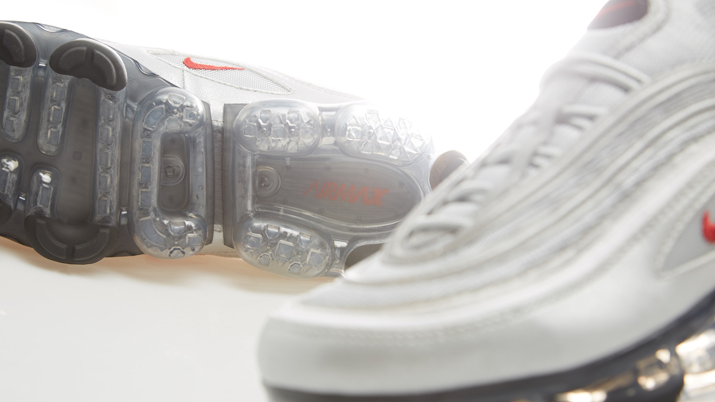 3e537576ae Here, the Swoosh present a silhouette that combines elements from the Nike  Air Max 97 and VaporMax models. Dressed in a celebrated 'Silver Bullet'  colourway ...