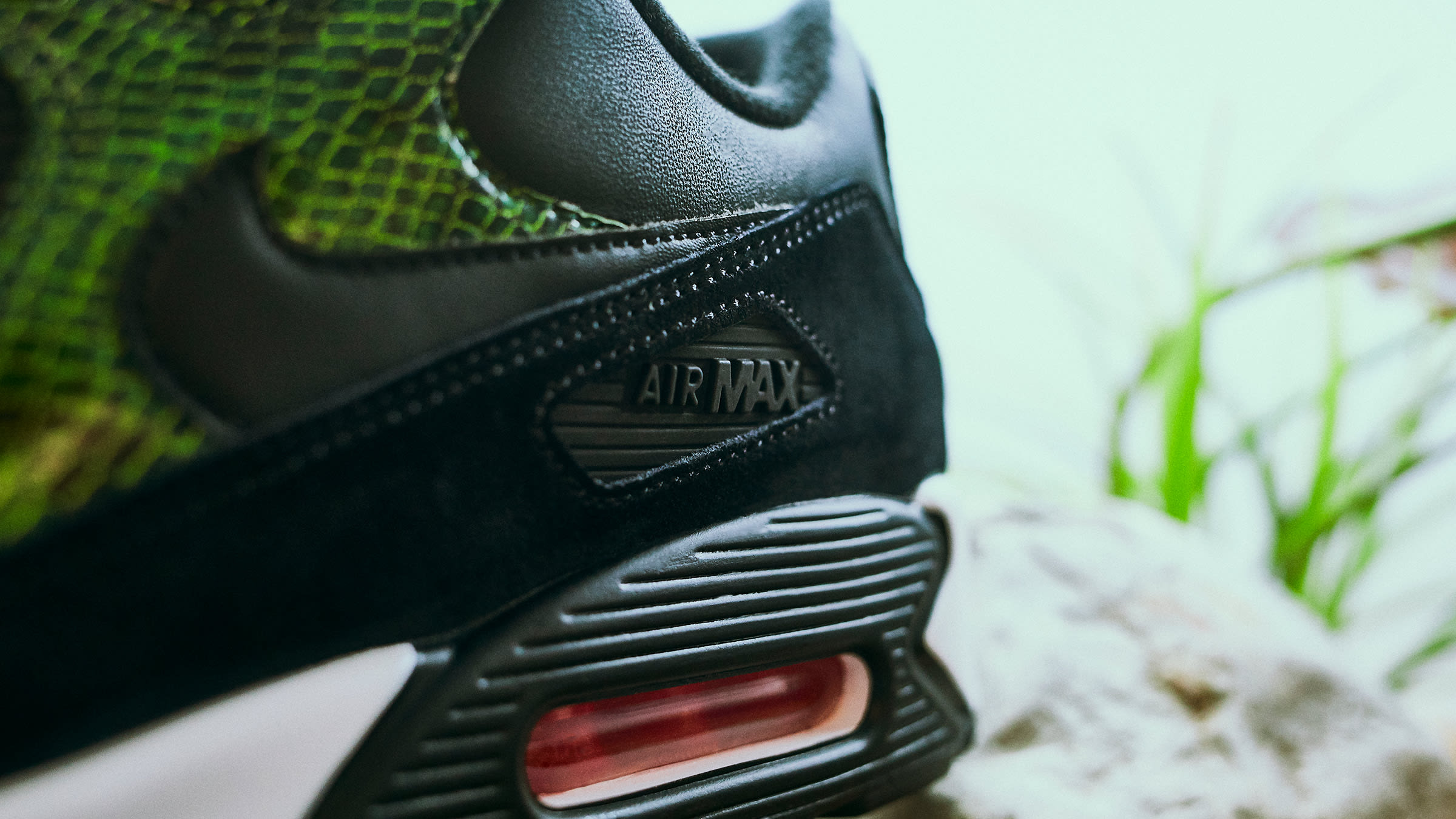 9b3a62774c Returning with an exotic twist this season, one of Nike's most iconic  silhouettes – the Air Max 90 – arrives in a solid black and cyber green  design.